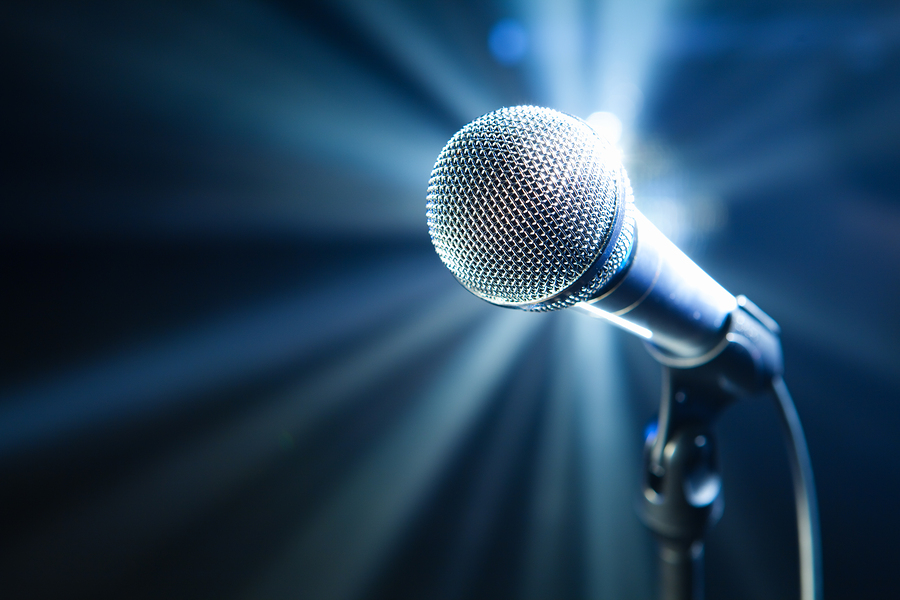 bigstock-microphone-on-stage-with-blue--26918891